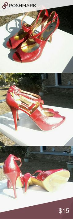 Carlos Santana platform peep-toe stilettos Amazing Carlos,  worn to a single event, then retired.   Very sharp pair of ultra clean and sanitary cranberry color peep toe platform stilettos,  all man made in size 9.5M.  4.5 inch heel, .5 inch platform,  without any visible defect. Carlos Santana Shoes Platforms