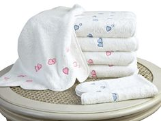 """Lovable 21 Bath Collection - For a touch of romance in the bath, let two hearts become one in Pink or Blue embroidery on ultra-absorbent White cotton terry, 600 grams per square meter. Lovingly made in Europe, with impeccably bound edges and piped scallops at both ends, these charming towels are a natural for """"his and hers"""".  Matching Short Robe for Her is available. #towels. #BathLinen #SchweitzerLinen #luxury"""