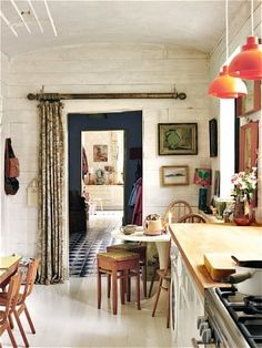 Scandinavian-style pale tones give way to a bolder scheme in an antiques   dealer's house.