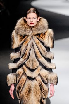 Viktor & Rolf - I hope the price is reduced for all the missing fur!?!  Just seems a bit busy and contrived.  Ok, and not to mention that animals gave their lives for it.