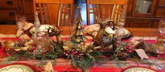 Southern Seazons: Rustic glam dining room. Love this reindeer centerpiece on plaid runner. Doing a version of this at Christmas