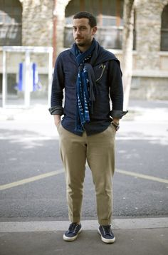 streetpeeper.com: Pesko  Top: SUPREME Denim ShirtScarves: Tie Dyed Scarf with a CLUB MONACO Shirt as ScarfPants: DRIES VAN NOTEN TrousersShoes: Navy Blue SUPERGA Shoes