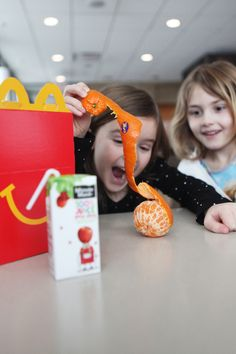 McDonald's Happy Meals ® make your kids smile. Hello, Cuties ®.  The perfect Happy Family Moment.