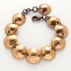 Celebrate 50 years with a penny bracelet made with 1965 US pennies.