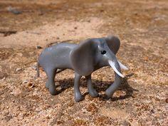 A Plastimake Elephant wanders through the desert.