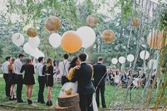 Balloons & paper lanterns instantly create an elegant outdoor atmosphere. Could be perfect for a wedding or at night for NYE!
