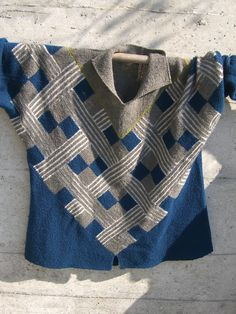 Free Knitting Pattern for Congo Sweater - Marianne Isager designed this striking graphic sweater for her book Knitting Out of Africa. The yoke is knit in modular units. There is an option for a v-neck or standup collar (pictured). Size: Small (47″), Medium (51″). Pictured project by barbarastrickt