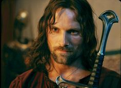 Aragorn played by the beautiful Viggo Mortensen. I love him intensely.