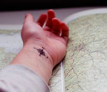 Get a (small...) compass tattoo.