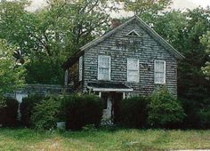 """Originally Capt. J. Norton Raynor's """"Old Farm"""" house located overlooking East Bay at East Moriches, LI, NY.  In the early 1900's his son, Horace Raynor had it moved to the present location on the west side of Atlantic Avenue, East Moriches.   photo by Van Field taken in 1999"""