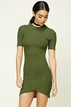 A brushed, ribbed knit mini dress featuring a bodycon silhouette, a high neck, short sleeves, and a tulip hem.