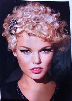 styling curly hair | Punk is a unique style for short curly haircut. This hairstyle gives a ...