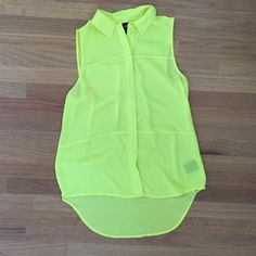 TARGET SLEEVELESS SHEER BUTTON DOWN color is a lot brighter! Worn a few times but the quality is still great! It says it's an extra small, but it would probably fit a medium as well. Very cute for summer and spring! target Tops Button Down Shirts