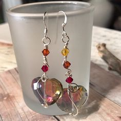 A Very Egalitarian Sort of Asymmetry Firepolished glass, silver wire, silver wire, sterling silver earwires.   https://nemb.ly/p/HkOvr6fne