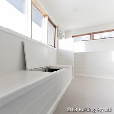 Bench seating with storage. Lining boards in dulux whisper white. Sisal carpet in natural. Baltic pine windows.