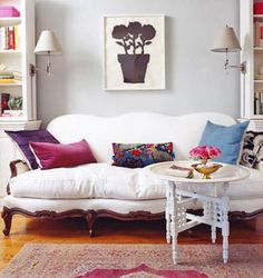 Love the carpet, the squishy looking cushion on the couch, and the Moroccan tea table. Not a fan of the painting, though