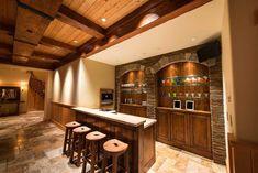 Rustic custom wood home bar with high ceilings