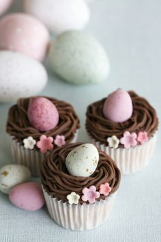 A simple mini Easter cake with piped chocolate icing and one mini egg.