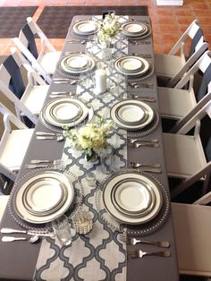 Mirage blue moroccan runner with platinum lamour table linens are a perfectly modern event style.