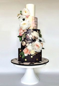 This floral black and gold wedding cake is perfect for a New Year's Eve wedding.