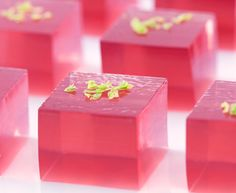Cosmopolitan Jello Shots: cranberry juice, flavored vodka, Grand Marnier, lime juice, and lime zest for garnish.