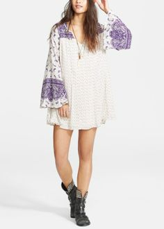 Such a pretty cream and lavender flowy paisley print dress | Free People