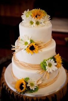 3 tier white fondant, Raffia trim and fresh Sunflowers Wedding Cake J Morris / http://www.himisspuff.com/country-sunflower-wedding-ideas/11/