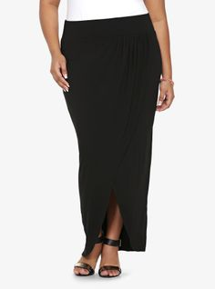 This black knit tulip maxi skirt delivers effortless drape with soft shirring and a crossover front design. Elastic waistband.