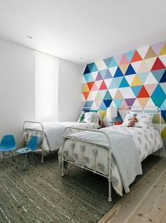 colorful accent wall ideas geometric pattern wallpaper iron bed frames wood…