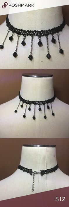 (F2) Choker Necklace Cute black choker necklace with dangling diamond shaped black beads. New in package. I get compliments on mine all the time! I love this! Can clasp anywhere from about 13 to 15 inches. This will stretch for larger necks. Jewelry Necklaces