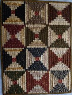 Small Courthouse Steps made during Jo Morton Little Women class.  Hand quilted, 2012 by marylou