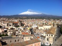 Adrano - Sicily - view from the top of the Norman Castle over the town and the snow covered Etna volcano