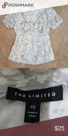 The Limited blouse The Limited blouse with a mild floral print and ruffling around the neck and arms. The Limited Tops Blouses