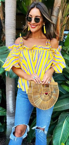 Office stripes just got a bold, bright twist with this cold-shoulder top in an energetic yellow hue and blue stripes. Jaunty Stripe Cold-shoulder Top in Yellow featured by Carrie Bradshaw Lied Blog