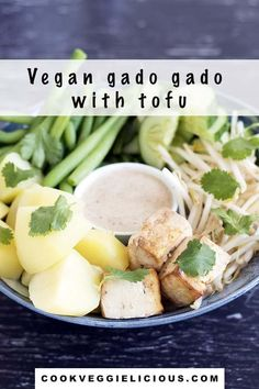 Try this vegan take on the traditional Indonesian salad, gado gado. It's made with tofu, potatoes, green beans, cucumber and bean sprouts and a delicious, zingy peanut sauce. #vegangadogado #gadogado #vegansalad #vegan #veganmeal #veganlunch #vegandinner