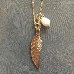 """Sequin Gold Angel Wing &Pearl Necklace. Brand new! """"Love-Guidance-Support"""" An Angel wing is a symbol of Divine presence to guide us that represents love, support and healing. Sequin Gold Angel Wing & Genuine Freshwater Pearl necklace. Beautiful linked gold chain with Angel Wing charm and Pearl. Gorgeous necklace! Longer necklace/hangs past chest. Would make a great gift! BRAND NEW/NEVER WORN/TAGS STILL ON! Materials: Freshwater Pearl, 22k Gold, Crystals Anthropologie Jewelry Necklaces"""