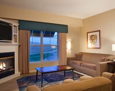 Spacious living rooms feature cozy fireplaces at Bluegreen Vacations The Suites at Hershey, an Ascend Resort in Hershey, PA.