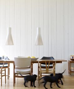 A cosy Scandinavian kitchen with white Secto 4200 pendants by Secto Design.