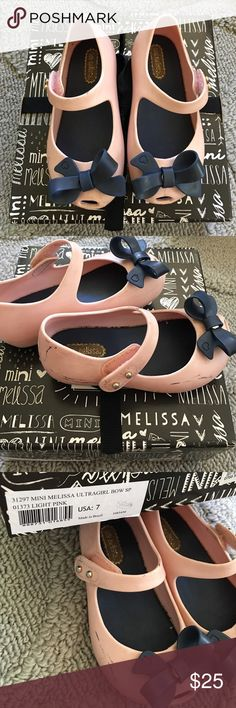 Mini Melissa Ultra Bow size 7 Mini Melissa Ultra Bow, Light Pink shoes with Blue Bow in size 7.  Still has its scent, but it has some scuff marks as shown in photo.   Comes from a pet free and smoke free home. Mini Melissa Shoes Dress Shoes