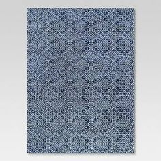 Create a harmonious, chic look in your space with this Aragon Area Rug from Threshold. Whether you want to transform the decor of your patio or your living room, this rug is sure to effortlessly add a dash of style to your home. Made of polyester, this rug is backed with slip-resistant latex. Rinse the rug with water for occasional cleaning.