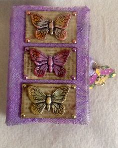 Butterfly Book 2.  Butterflies made from clay mounted to stamped cardstock mounted to chipboard and covered with Judikins Fluxe.  Clasp is a metal blank I hand painted then covered with Judikins.  Looks like enamel.