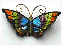 1970's brooch by David Andersen ...a distinctive effect the co. is famous for is achieved by a pattern being stamped into the silver and it then shows thru the translucent colored enamel