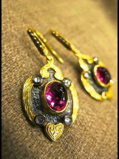 Handmade silver gold plated earrings with tourmaline in the middle