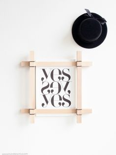 DIY paint stick frame ::: excitingly simple! Cheap and unique frames for pictures in the living room
