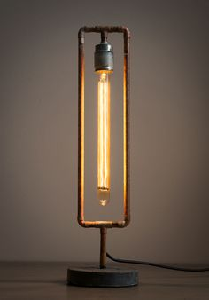 This lamp is build from brass pipes and a 30 cm long light bulb.