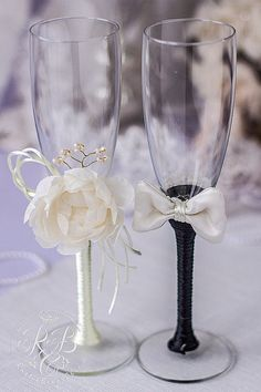 Bride and groom champagne flutes, ivory & black, rustic wedding, flower toasting…