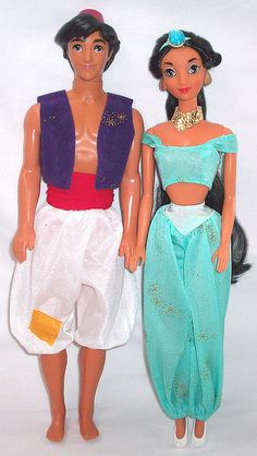 "Original Aladdin & Jasmine ""Barbie"" dolls.---Still have them packed away. I bet poor Jasmine's hair is all tangled."