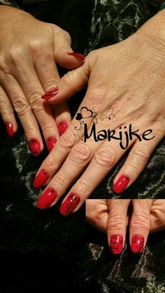 Red nails with black freehand nailart.
