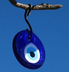 Evil eye hanging from a tree in Cappadocia, Turkey. Evil eyes are meant to ward off evil Turkish Restaurant, Mystic Eye, Turkish Eye, Cradle Of Civilization, Greek Evil Eye, Ancient Symbols, Evil Eye Charm, Art Plastique, Hamsa