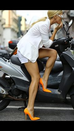 white outfit with pop of orange